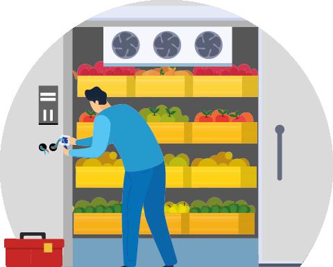 Engineer servicing walk in fridge